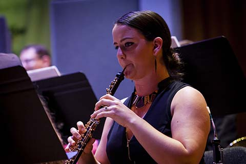 Woodwind musician performs during an event at the University of Miami