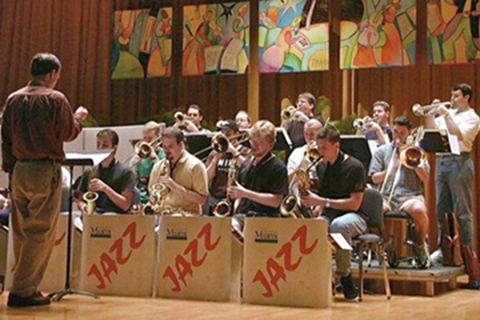 Big Band ensemble performs on stage at a Miami Jazz Event